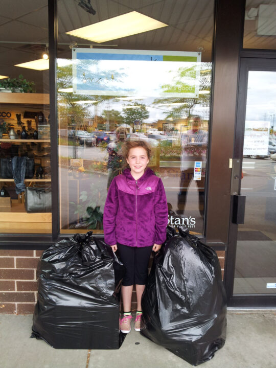 Cassidy with some of the donated shoes she collected!