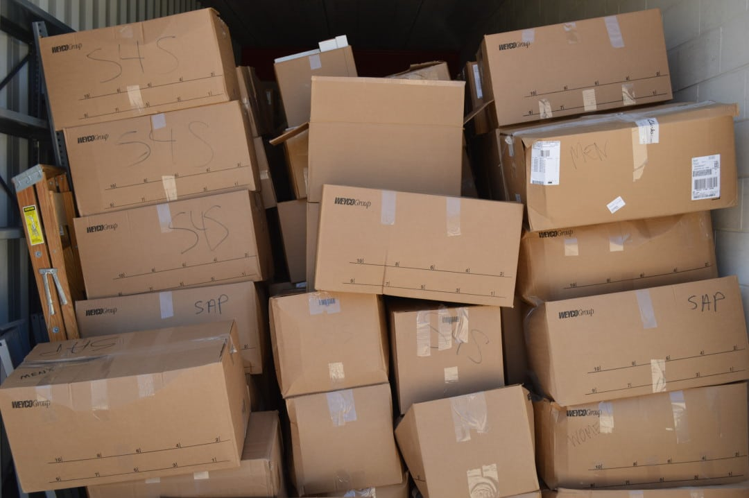 Piles of Share-A-Pair shoe drive boxes.