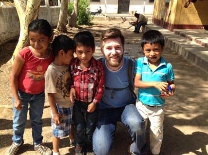 Ben with school children